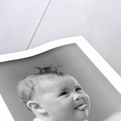1940s Cute Baby Sticking Out Tongue Studio by Corbis