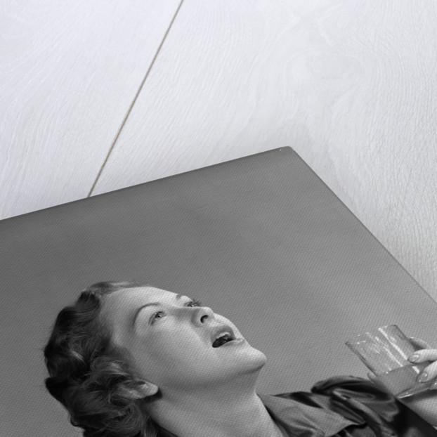 1940s 1950s Woman Gargling by Corbis