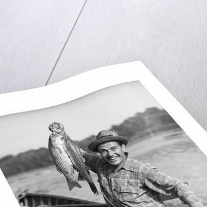 1940s 1950s Happy Man Fishing From A Rowboat Holding Up Fish Just Caught With Pride by Corbis