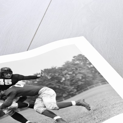 1940s Football Player Being Tackled by Corbis