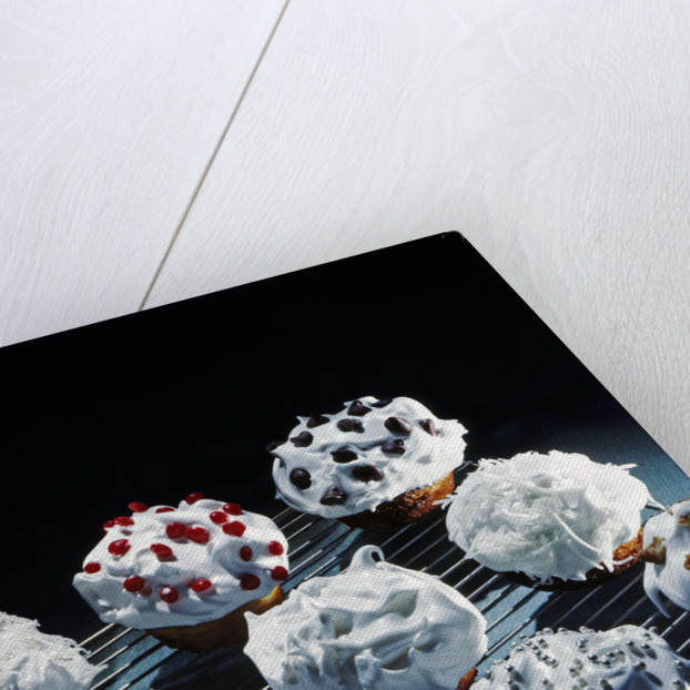 1950s Cupcakes White Icing Decorations Chips Jimmies Nuts On Metal Cooling Rack by Corbis