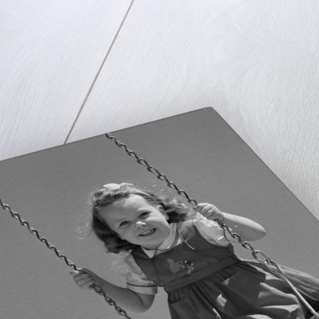 1940s Girl Swinging On Playground Swing by Corbis