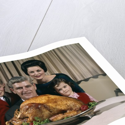 1960s Portrait Of Family Looking At Thanksgiving Or Christmas Roast Turkey by Corbis