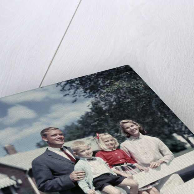 1950s 1960s Family Portrait Mother Father Daughter Son At White Fence Of Suburban Home by Corbis