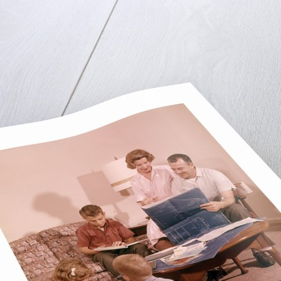 1960s Family In Living Room Looking At New House Blueprint Plans ...