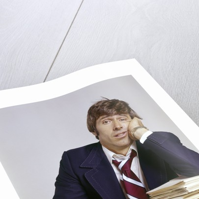 1970s Business Man Exhausted Expression Hand To Face Leaning On Pile Paperwork by Corbis