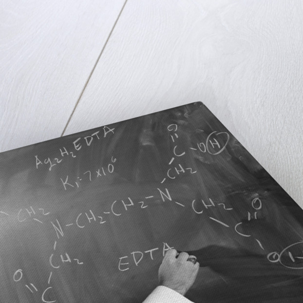 1960s Profile Of Scientist Man In Lab Coat Writing Out Chemical Formula On Blackboard by Corbis