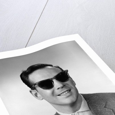 1950s 1960s Portrait Of Blind Man Wearing Sports Jacket Shirt And Very Dark Protective Sunglasses by Corbis