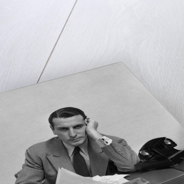 1940s Tired Overworked Man Businessman Leaning On Elbow Looking At Camera by Corbis