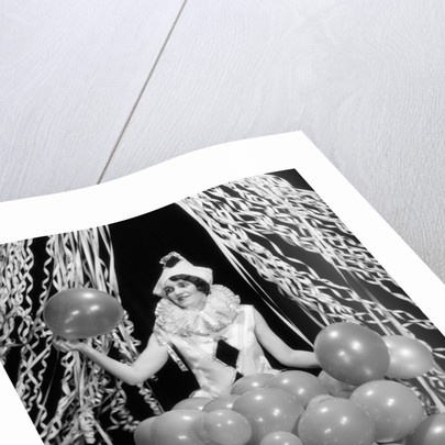 1920s 1930s Young Woman Pierrot Clown Amid Party Balloons And Paper Streamers by Corbis