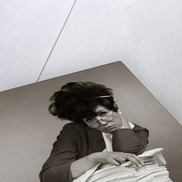 1960s 1970s Secretary with Pencil Stuck In Teased Hair Overworked Expression by Corbis