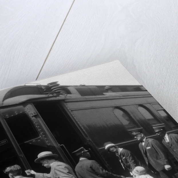 1920s Family Boarding Passenger Train Assisted By Trainman And Porters Carrying Luggage Outdoor by Corbis