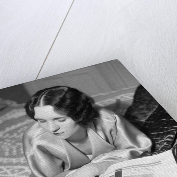 1920s 1930s Reclining Woman With Marcel Wave Hair Style Reading A Fashion Magazine by Corbis