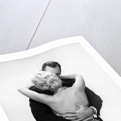1950s 1960s Wife In Backless Satin Gown Evening Dress And Husband Embracing And Kissing by Corbis