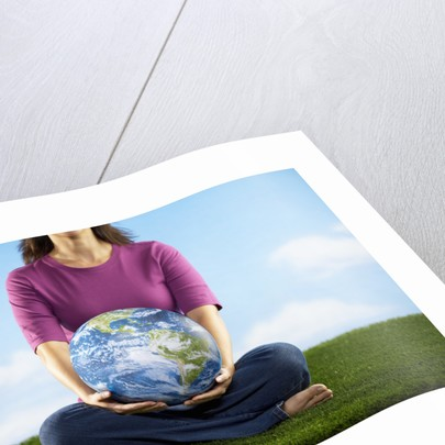 Woman Holding Earth in Her Lap by Corbis
