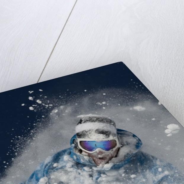 Skier in deep powder snow by Corbis