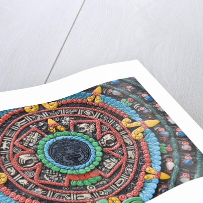 Carved and painted Aztec calendar design by Corbis