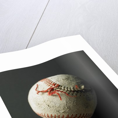An old baseball with its stich ripped by Corbis