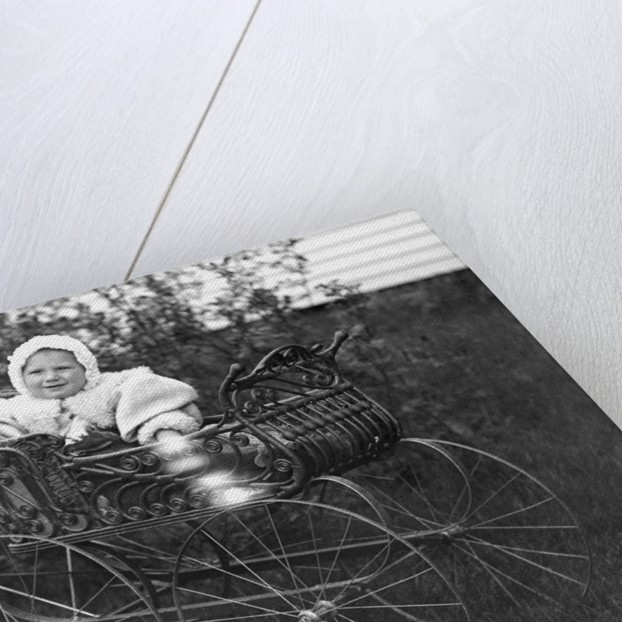 Baby in a baby carriage, ca. 1895. by Corbis