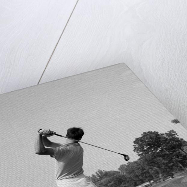 1970s man swing golf club by Corbis