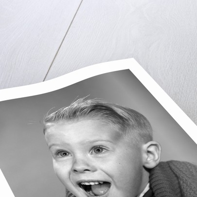 1960s young blond boy with happy surprised facial expression by Corbis