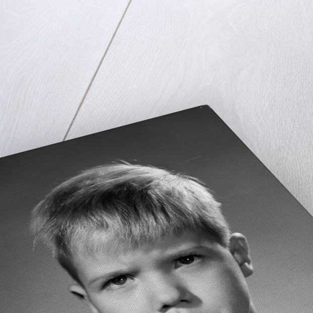 1950s portrait blond boy sad grumpy angry pouting facial expression looking at camera by Corbis