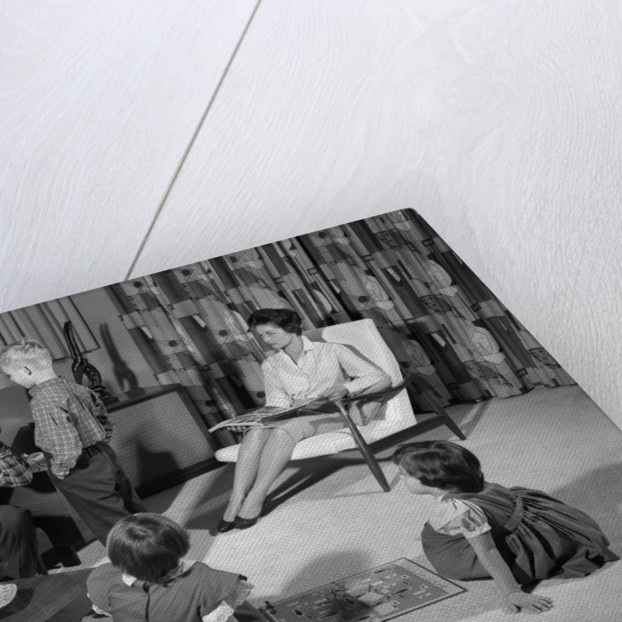 1960s family of four in living room boy is being disciplined by dad shaking finger by Corbis