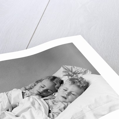 1940s two children boy and girl sleeping in bed by Corbis