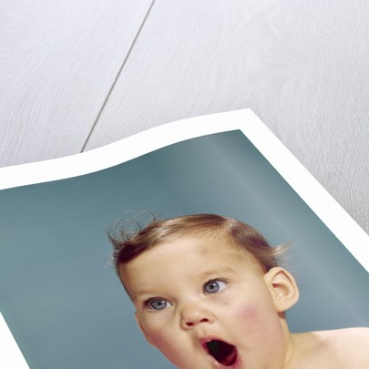 1960s baby portrait mouth wide open shocked facial expression by Corbis