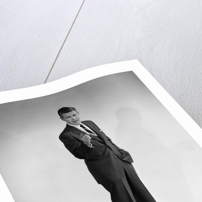1960s man in business suit standing pointing finger looking at camera by Corbis