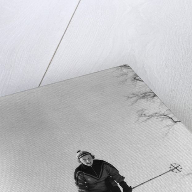 1930s woman holding ski poles skiing in snow by Corbis