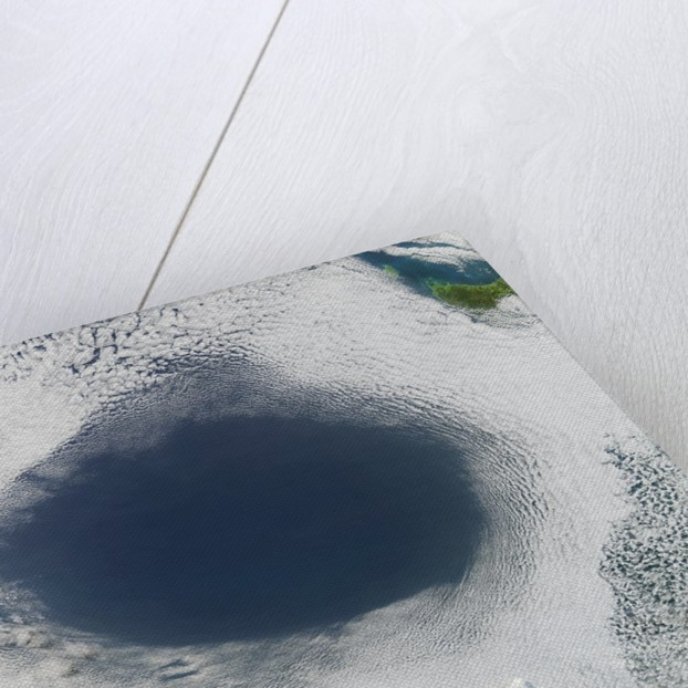 Cloud hole caused by intense high pressure system by Corbis