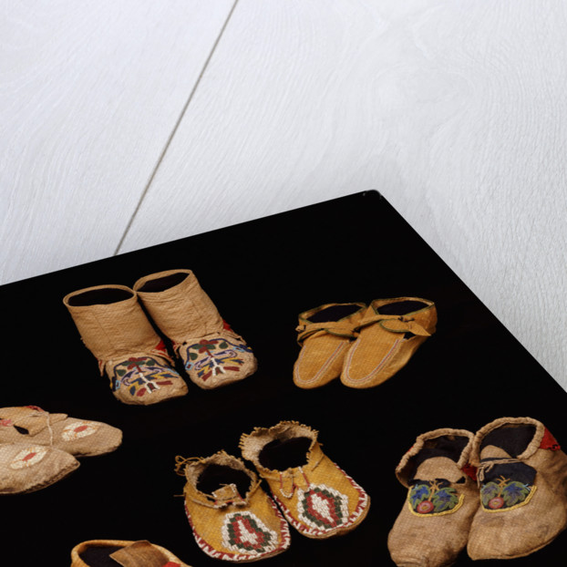 A selection of American Indian hide moccasins from various tribes by Corbis