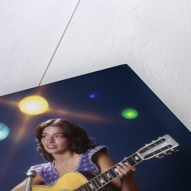 1970s Woman Girl Performer Playing Guitar Singing Microphone Stage Lights by Corbis
