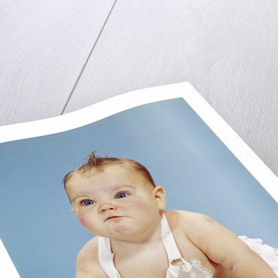 1960s Baby Making Funny Face Pushed Up On Arms Crawling Forward by Corbis