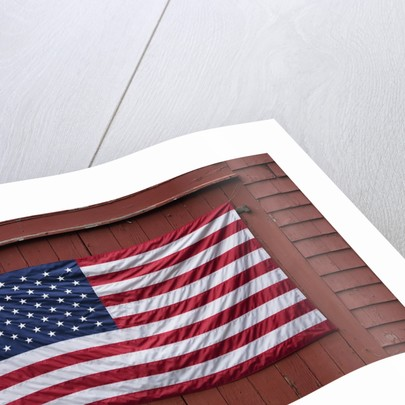 US Flag displayed on Red Barn, New England by Corbis