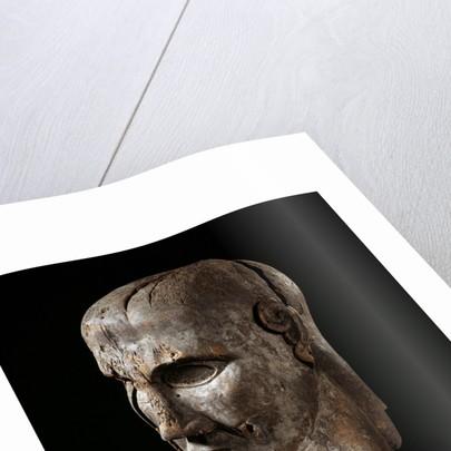 Etruscan sculpture of virile head by Corbis