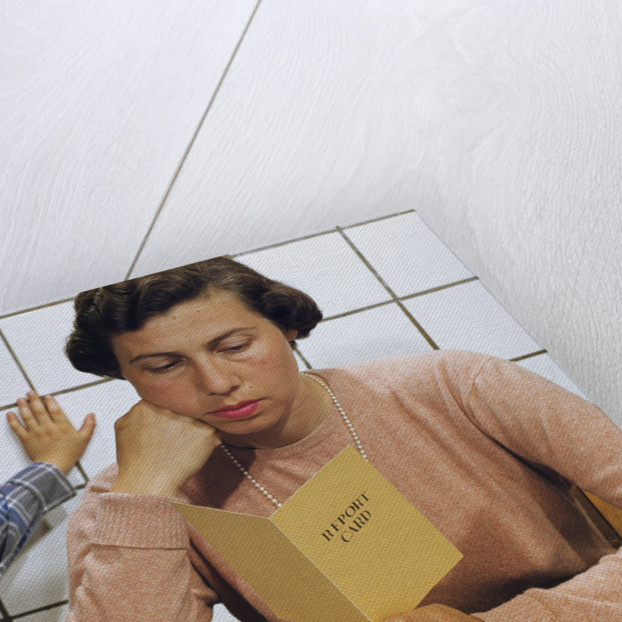 Disappointed Mother Reading Son's Report Card by Corbis
