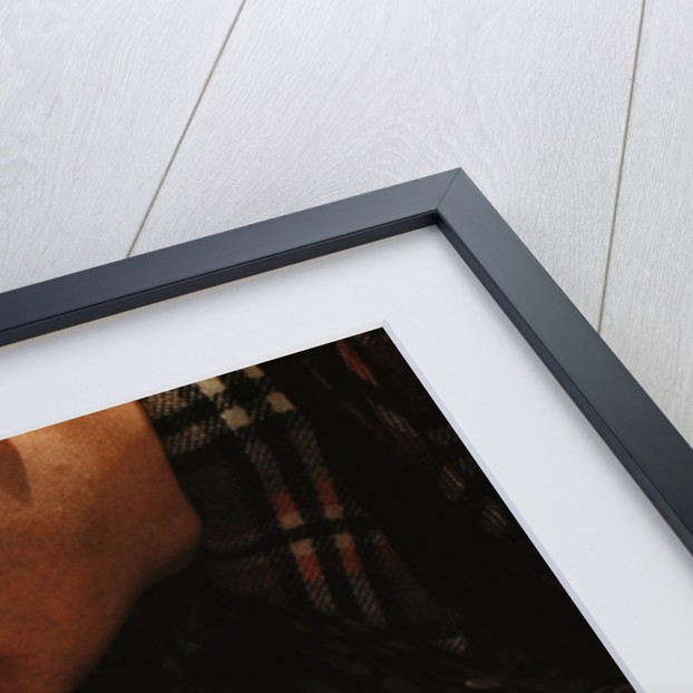Man Fixing Knob on Screen Door by Corbis