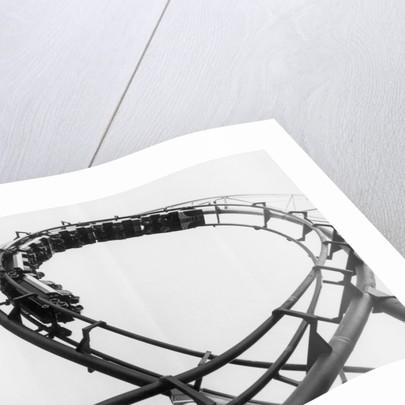 Car Going Through Roller Coaster Loop by Corbis