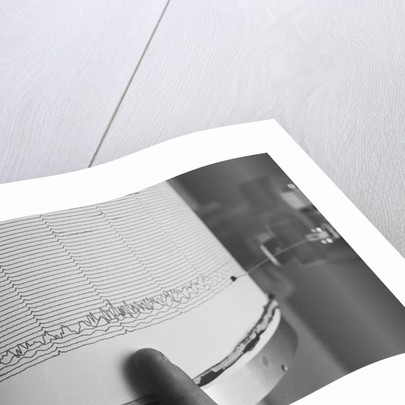 Finger Pointing to Earthquake Reading on Seismograph by Corbis