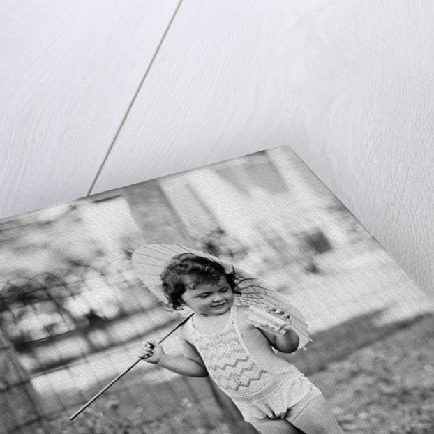 Girl Holding Parasol by Corbis