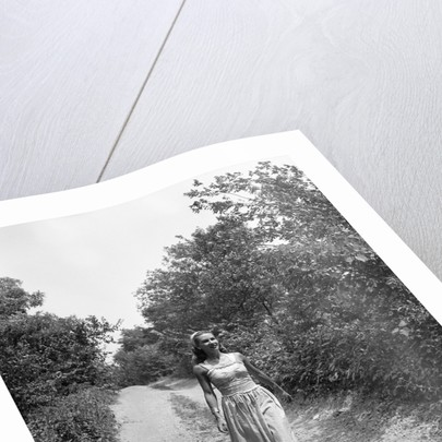 Woman Walking on Country Road by Corbis