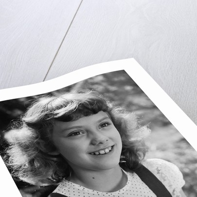 Girl Smiling by Corbis