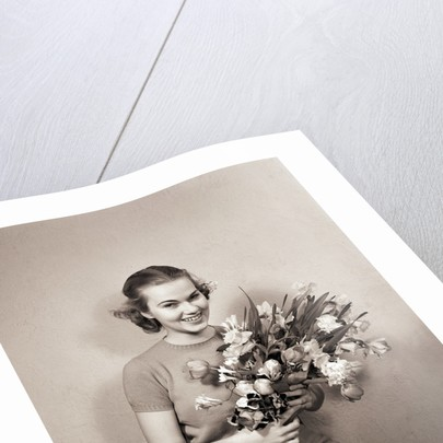 Seated Girl Holding Flowers by Corbis