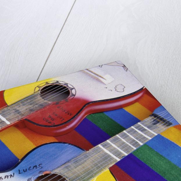 Colorful Souvenir Guitars by Corbis