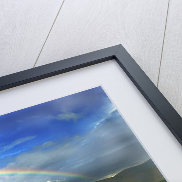 Rainbow Over Valley by Corbis