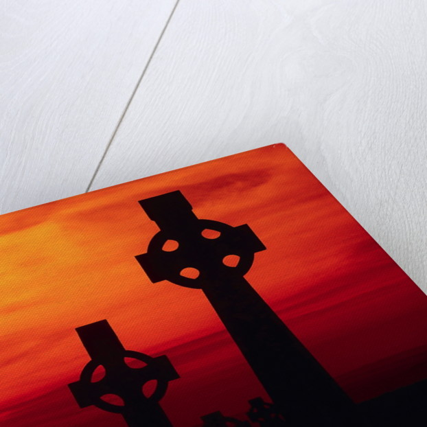 Celtic Crosses Silhouetted at Sunset by Corbis