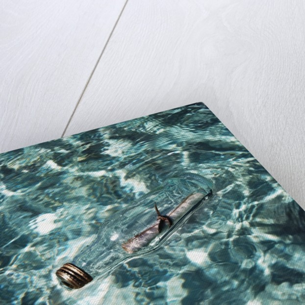 A message in a bottle adrift at sea by Corbis