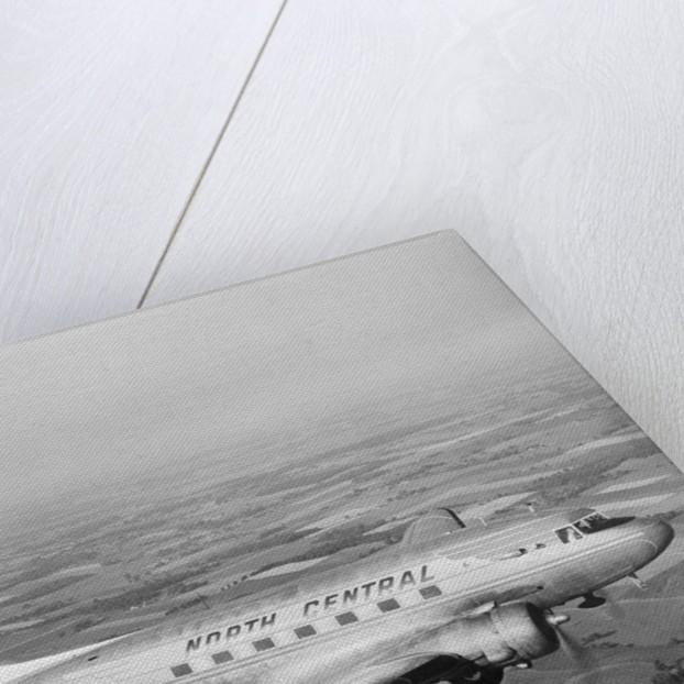 Douglas DC-3 Plane in Flight by Corbis